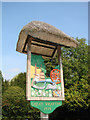 TL6848 : Great Wratting village sign (detail) by Adrian S Pye
