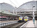 SJ8497 : Departures from adjacent platforms by Stephen Craven
