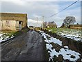 SE2703 : Trans Pennine Trail (TPT) passes through Far Coates farmyard by Steve  Fareham