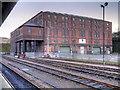 SE1416 : Large Brick Warehouse at Huddersfield Station by David Dixon