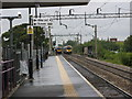 SJ8590 : Trains Crossing North of East Didsbury Station by Stephen Armstrong