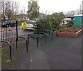 SO9548 : Bicycle racks and a notice stating the obvious, Pershore railway station by Jaggery