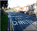 ST3090 : Bilingual message on the surface of Pillmawr Road, Malpas, Newport by Jaggery