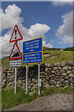 NY2101 : Road Sign to Hardknott Pass, Cumbria by Christine Matthews