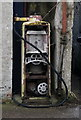 SN3010 : Petrol pump on King Street, Laugharne by Ian S