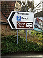 TM4557 : Roadsign on Church Farm Road by Adrian Cable