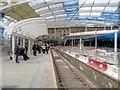 SJ8499 : Refurbished Metrolink Platform at Manchester Victoria (February 2015) by David Dixon
