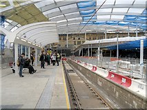 SJ8499 : Refurbished Metrolink Platform at Manchester Victoria (February 2015) by David Dixon