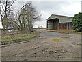 TM2195 : Large storage shed at Fairstead Farm by Adrian S Pye