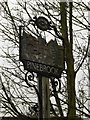 TM1242 : Pinebrook Village sign by Adrian Cable