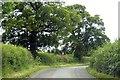 SP7125 : Rural road round Claydon Park by Steve Daniels