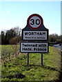 TM0877 : Wortham Village Name sign by Adrian Cable
