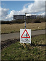 TM0677 : Roadsign on Magpie Green by Adrian Cable