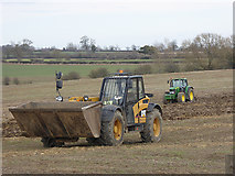 NZ2218 : Tractor and dumper at Castle Farm by Oliver Dixon