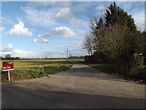TM3071 : Entrance to Boats Hall Farm by Adrian Cable