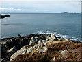NM4771 : Promontory east of Port Eigin-aig by John Allan