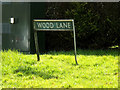 TG1902 : Wood Lane sign by Adrian Cable