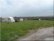 SW8774 : Field with scattered semi-derelict caravans by Anthony Parkes