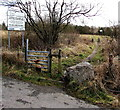 SS8694 : Stile to a track through a colliery tip restoration site, Caerau by Jaggery