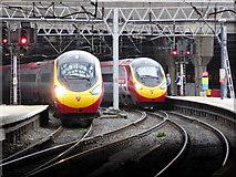 SP0786 : Pendolinos at New Street by John Lucas