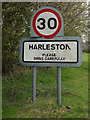 TM0160 : Harleston Village Name sign on Haighley Road by Adrian Cable