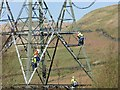 SK1099 : Riggers working on the pylons by Steve  Fareham