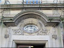 NZ2564 : Pretty putti over the entrance to 112-118 Pilgrim Street, NE1 by Mike Quinn
