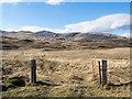 NM7031 : Moorland beyond gateway by Trevor Littlewood