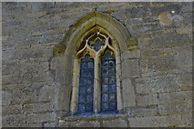 SK8707 : Egleton: St. Edmund's Church: Detail of small window in the north wall by Michael Garlick