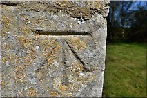 SK8707 : Egleton: St. Edmund's Church: Benchmark on the external chancel wall by Michael Garlick