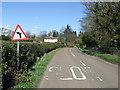 NU2002 : Minor road near Acklington Park by JThomas