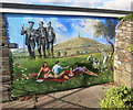 SX3569 : Wall Painting in Callington by Des Blenkinsopp