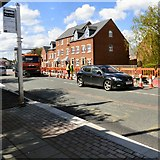 SJ9495 : Footpath repairs on Manchester Road by Gerald England