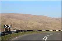 NT0612 : Sharp bend on A701 above Devil's Beef Tub by Leslie Barrie