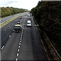 SS9082 : White vans enter the M4 westbound from junction 36, Sarn by Jaggery