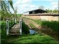 SK6414 : Footbridge and ford alongside Manor Farm by Alan Murray-Rust