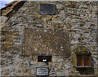 SP1106 : Bibury; National Trust  plaques on the last cottage in Arlington Row by Michael Garlick