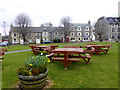 NJ1618 : Picnic tables on Tomintoul Square by Oliver Dixon