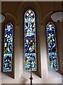 NY3250 : St Andrew, Thursby: stained glass windows (2) by Basher Eyre