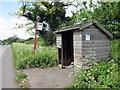 SJ4740 : Bus Shelter at Eglwys Cross by Jeff Buck