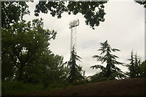 TQ3470 : View of one of the floodlights of the National Sports Centre from Crystal Palace Park #3 by Robert Lamb