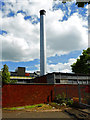 SP0664 : Tudor Grange Academy - chimney  by Chris Allen