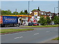 SP1183 : Shell filling station and houses on Stockfield Road by Richard Law