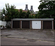 SU3521 : Four lockup garages and two old brewery chimneys in Romney by Jaggery