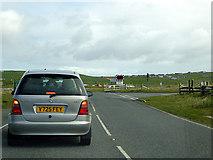 HU3810 : Waiting to cross the runway at Sumburgh Airport by John Lucas