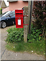TM0956 : 12 All Saints Road Postbox by Adrian Cable