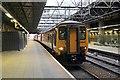 SJ8499 : Northern Rail Class 156, 156487, platform 3, Manchester Victoria railway station by El Pollock