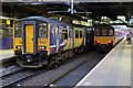 SJ8499 : Northern Rail Class 150s, Manchester Victoria railway station by El Pollock