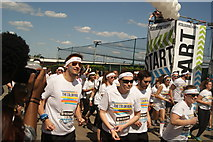 TQ1985 : View of the Colour Runners taking off from the start line #5 by Robert Lamb