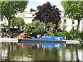 TQ2681 : Pride of London -  canal maintenance boat in Little Venice by David Hawgood